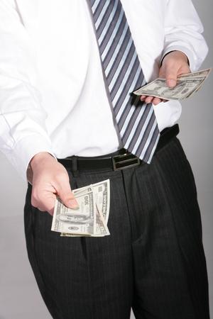 papermoney: Close up shot of hands giving money bills