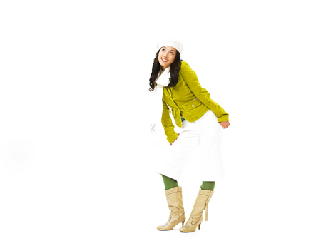 Young Asian female fashion model posing in a studio wearing green olive tone outfit with white beret hat