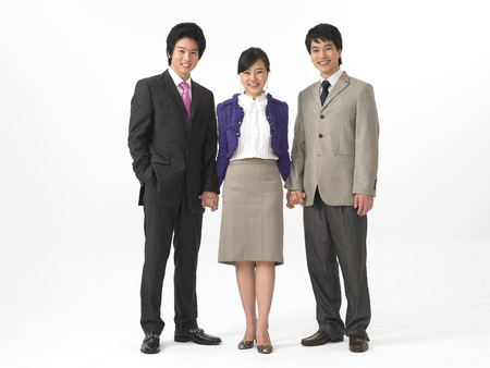 Two Asian men and a woman in formal business suits posing in a studio
