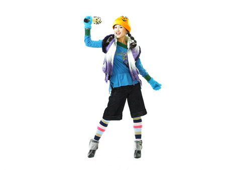 Young Asian female fashion model posing in a studio as dressed up like a tomboy with a magic horn stick prop