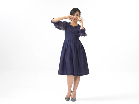 Asian woman model formal look fashion isolated in white wearing navy blue dress