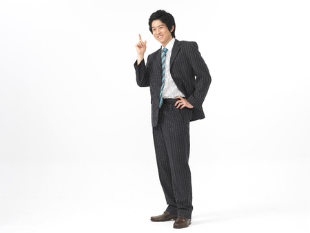 Asian man model formal business look fashion posing in a studio with hand gesture
