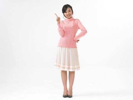 Asian woman model formal look fashion isolated in white wearing pink tone outfit with gesture