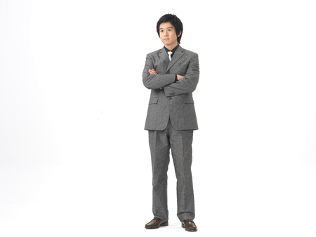 Asian man model formal business look fashion posing in a studio with gesture