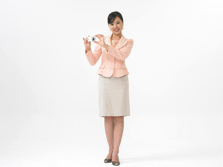 Asian woman model formal look fashion isolated in white wearing skirt suit with camera