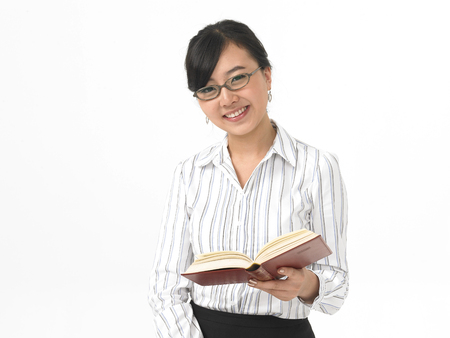 Close up shot of business woman isolated in white with a book
