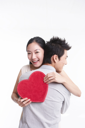 Young Asian couple posing in the studio - isolated on white