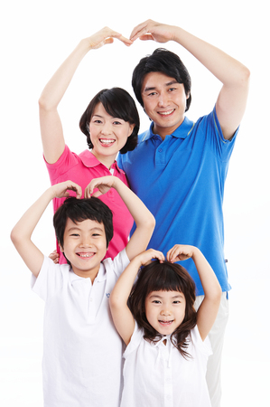 Asian family making heart with their arms - isolated on white