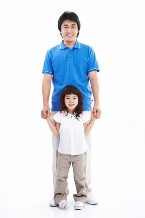 Asian dad and daughter smiling together - isolated on white Stock Photo