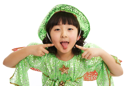 Close of Asian girl in fairy dress sticking out her tongue isolated on white