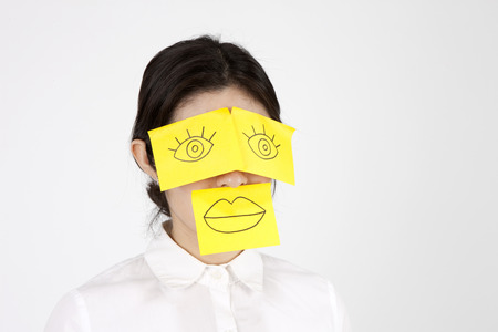 Close up Asian business woman with post-it mask isolated on white Stock Photo - 86366882
