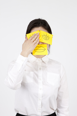 Asian business woman with post-it mask isolated on white