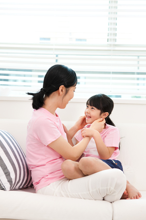 Asian mother and daughter have a good time together