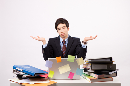 Asian stressful man having a headache with lots document isolated on white