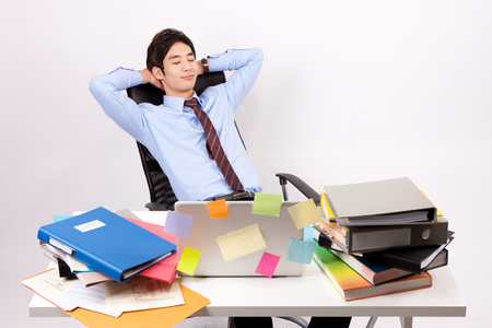 Asian stressful man taking a short break with lots document isolated on white