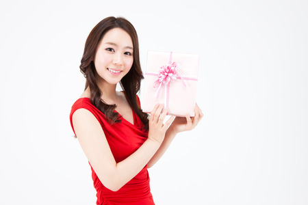 Portrait of Closeup Asian beautiful woman with gift box isolated on white Stock Photo