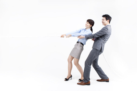 Portrait of Asian business couple struggling to win. pulling rope isolated on white Stock Photo