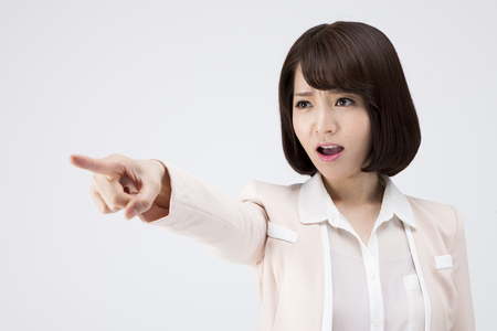 Portrait of Asian angry teacher expressing giving a scolding isolated on white