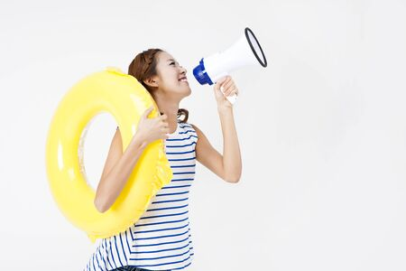 loudspeaker: Portrait of Asian beautiful woman shouting with loudspeaker and inflatable ring on summer day isolated on white