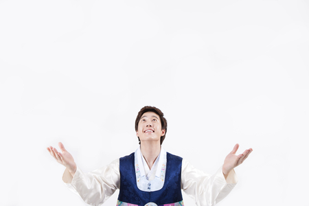 Asian man in Korean traditional clothes looking upper isolated on white Stok Fotoğraf