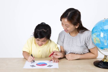 children painting: Multicultural family mother and daughter drawing Korean flag isolated on white