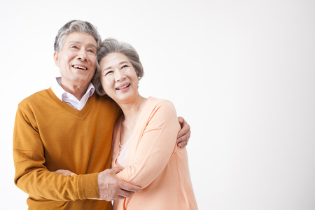 Asian old aged couple having good time isolated on white