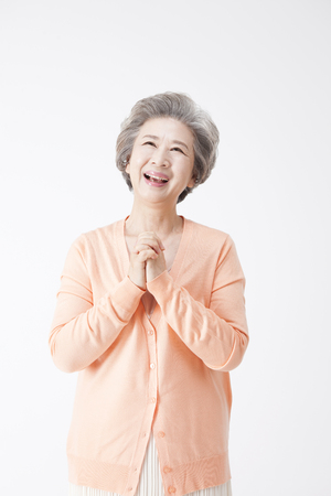 Asian old aged woman looking happy isolated on white