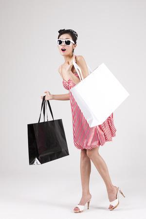 Asian retro woman shopping isolated on white