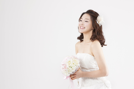 Asian beautiful bride with smile isolated on white Stock Photo