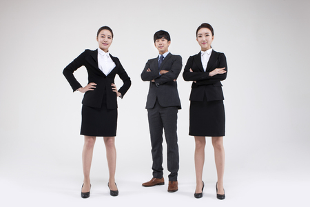 Group of Asian business people looking confident isolated on white