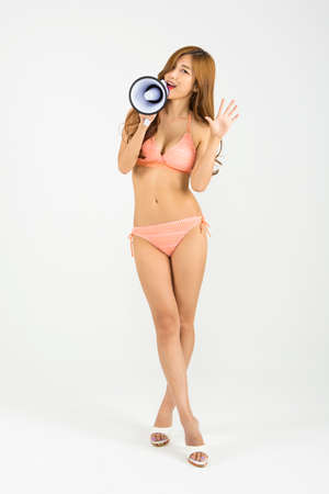 Asian happy woman in swim wear with loudspeaker isolated on white