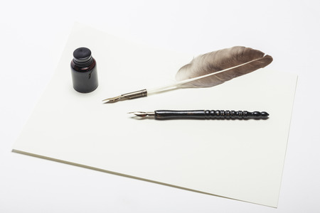 Feather quill and Fountain pen isolated on white Stock fotó