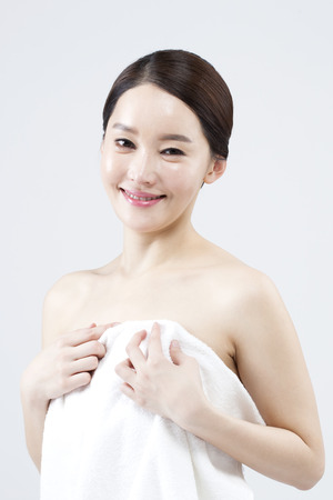 Asian beautiful woman wrapped with shower towel isolated on white Stock Photo