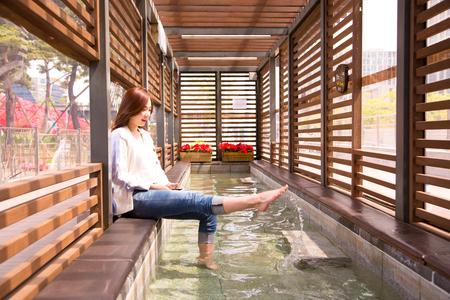Asian beautiful woman dabble in water Stock Photo