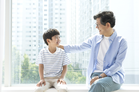 Asian grandfather and grandson looking happy