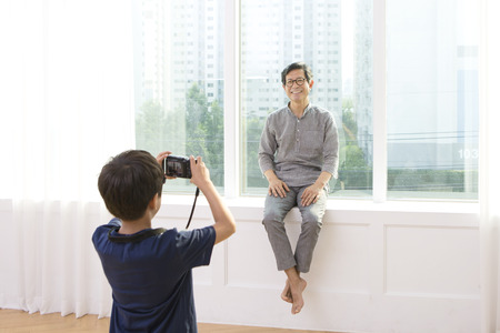 Asian grandfather and grandson taking picture Stock Photo