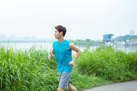 Asian young man jogging outdoor