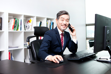 Asian man working in office