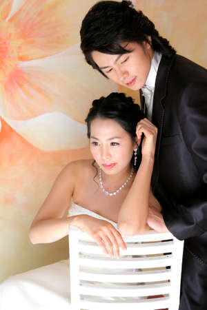 Young Asian wedding couple posing in the studio Stock Photo