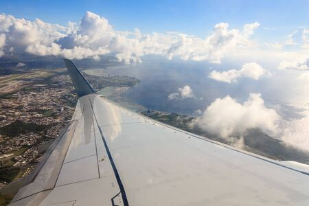 Aircraft on clouds in the sky Stock Photo