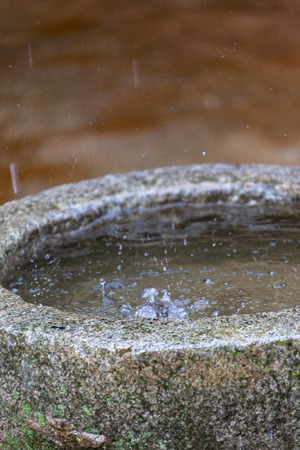 Rain falling on stone rain gutter