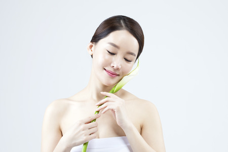 Asian beautiful woman with flower isolated on white
