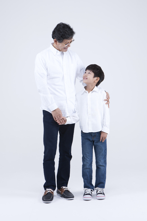 Asian grandfather and grandson with smile isolated on white