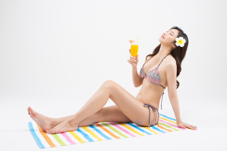 Asian woman in bikini on summer vacation day isolated on white