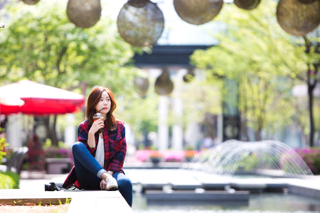 Asian beautiful woman drinking coffee at outdoor café Stock Photo