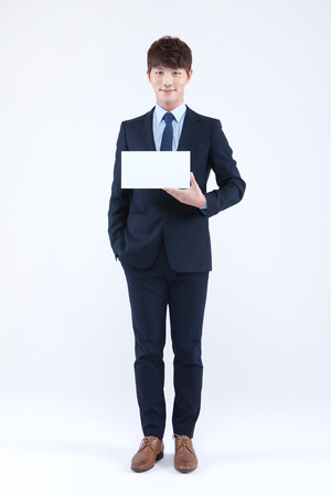 Asian man in suit with panel isolated on white Stock Photo