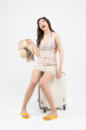 Asian woman going vacation trip isolated on white