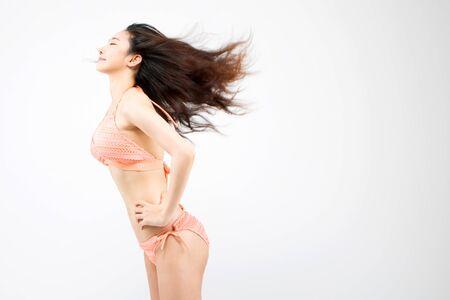 Asian woman in bikini posing isolated on white Stock Photo
