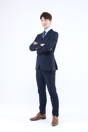 Asian man in suit looking confident isolated on white