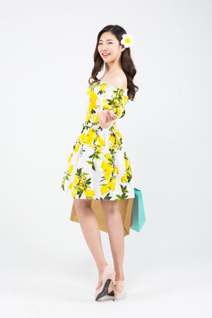 Asian woman in bikini shopping isolated on white Stock Photo